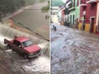 Desborda presa  e inunda calles